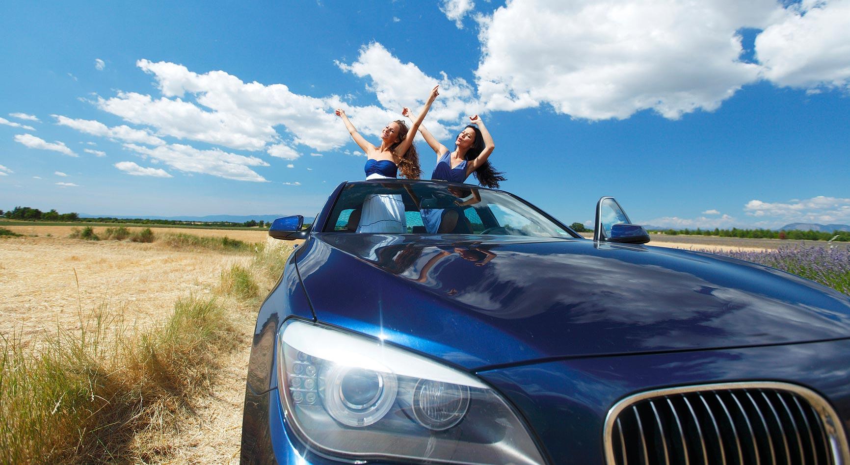 women dance in car